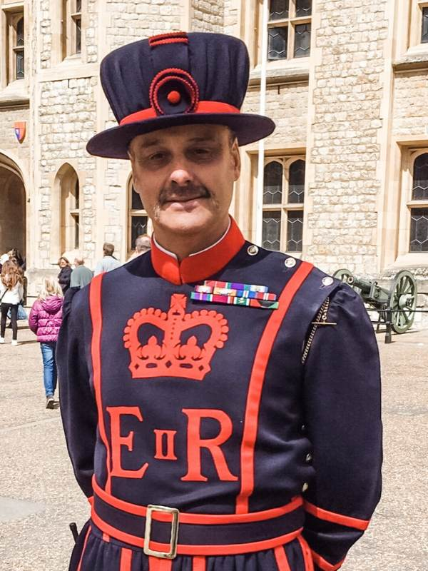 A picture of a man dressed in Yeoman of the guard uniform at the Tower of London a London bucket list destination for many