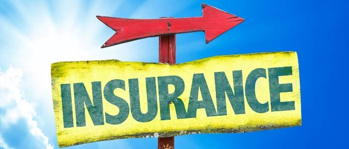 THE WORD INSURANCE WITH A RED ARROW WRITTEN ON A WOODEN BOARD