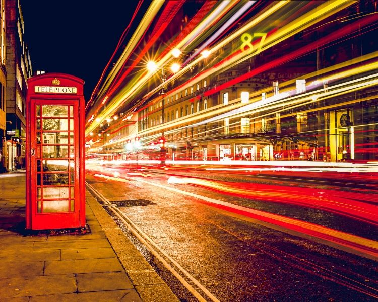 A london telephone box and lights from buses and cras