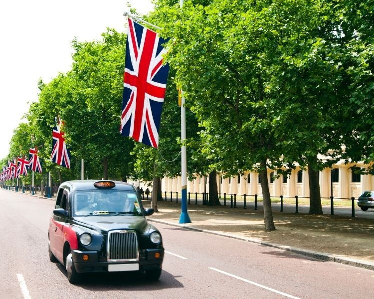 London taxi cab on a street with Union Jacks