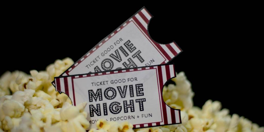 A picture of movie tickets and popcorn a great way to watch movies set in London