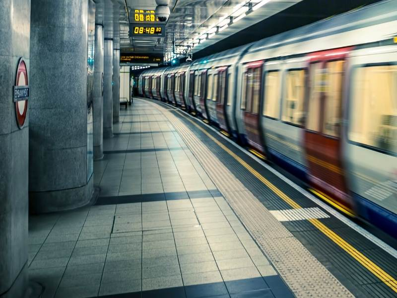 A picture showing a tube train leaving a station on the London Underground