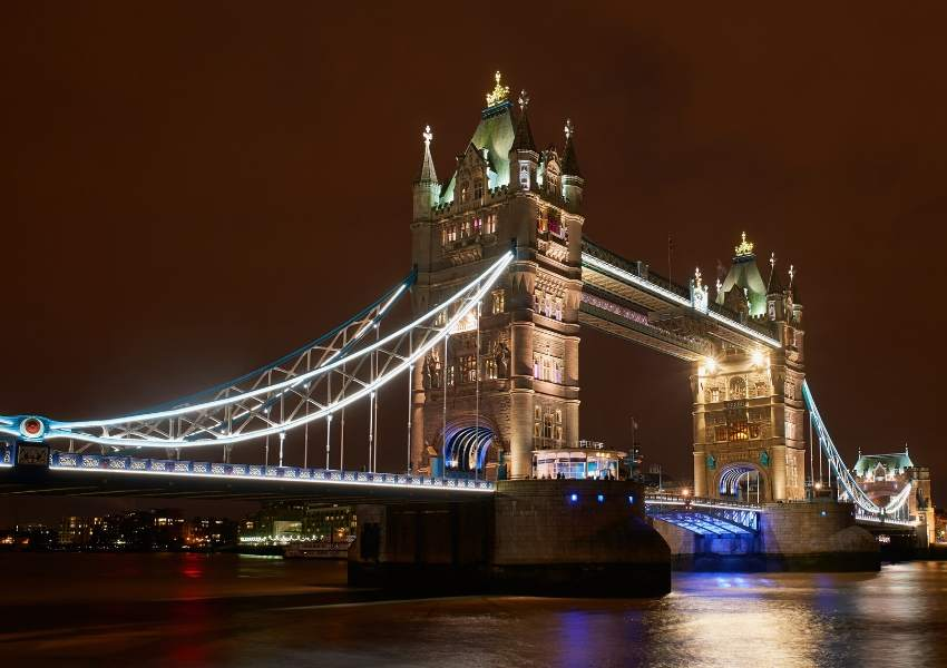 A night picture of Tower bridge with lights along it