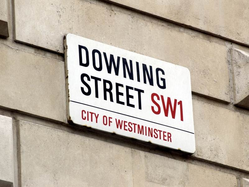 A picture of the street sign for Downing Street in London