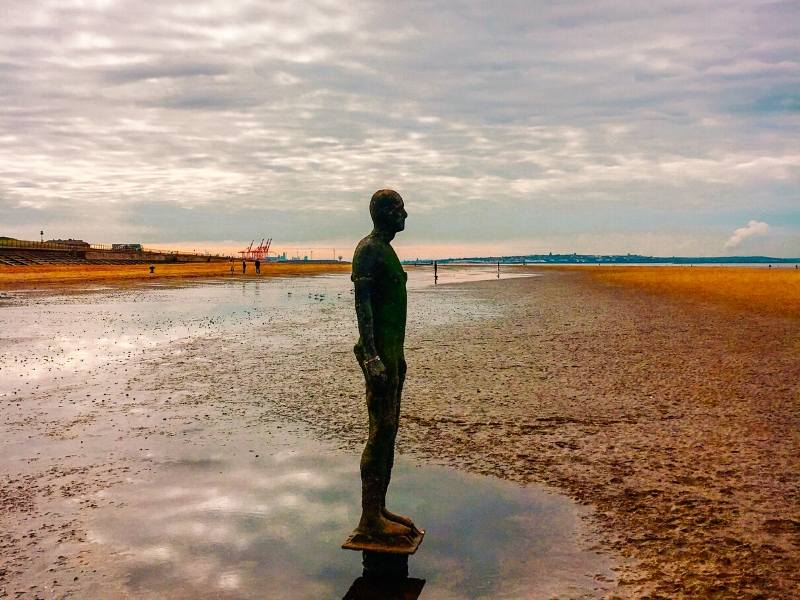 A picture of one of Anthony Gormley's statues at Crosby Beach one of the recommended places to visit in North West England