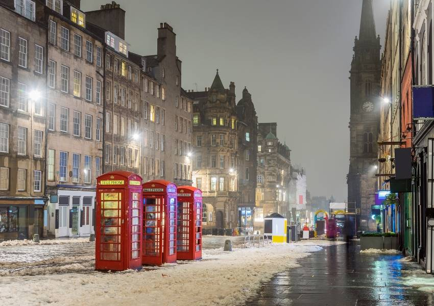 A snowy evening street scene in Edinburgh Scotland