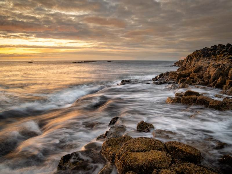 A picture of the sea lapping onto rocks