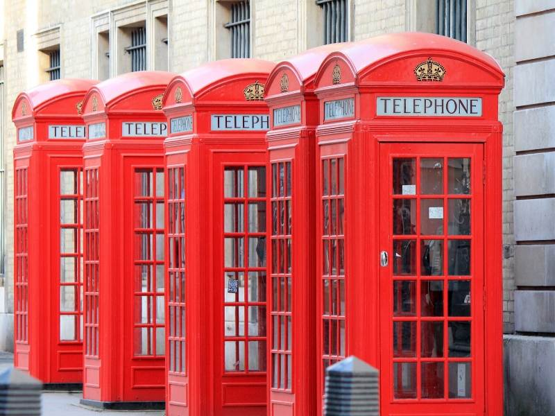 A row of red phone boxes in London