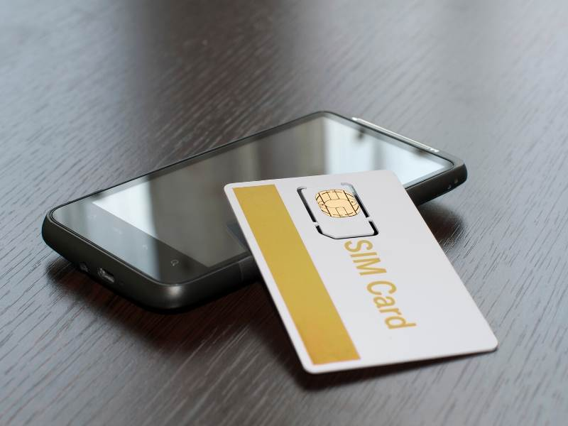 A picture of a phone and a sim card