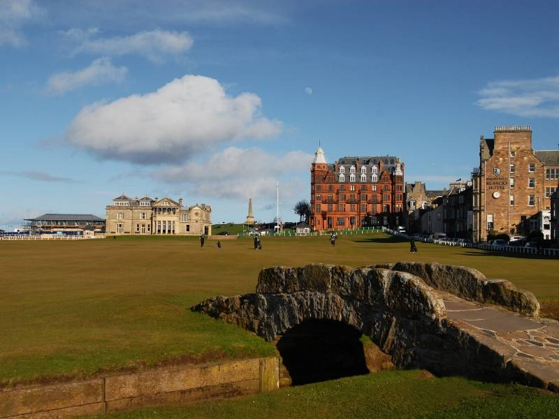A golf course with a bridge in St Andrews a popular place to visit in Scotland