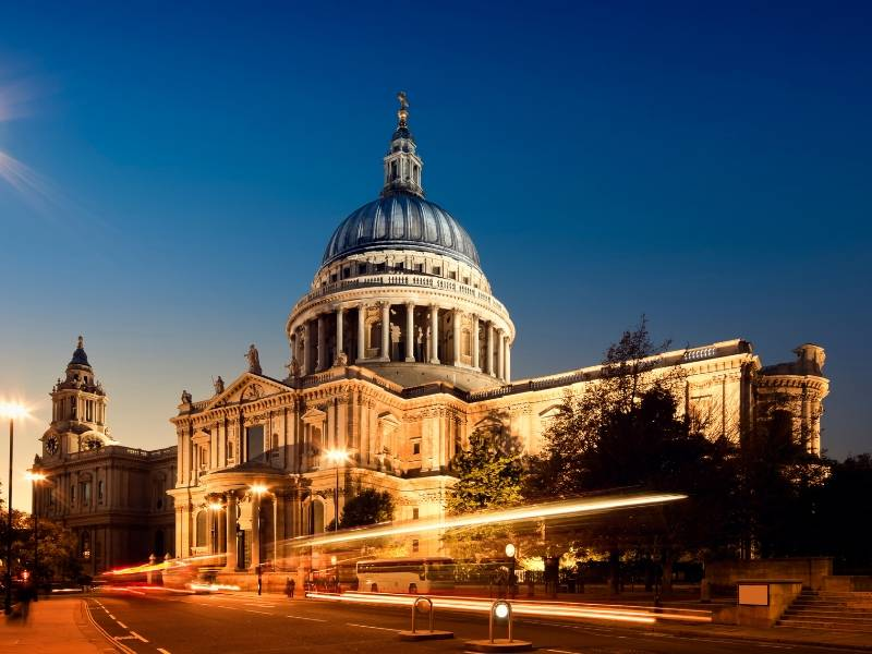 A picture of St Paul's Cathedral lit up at night one of the most famous landmarks in the UK