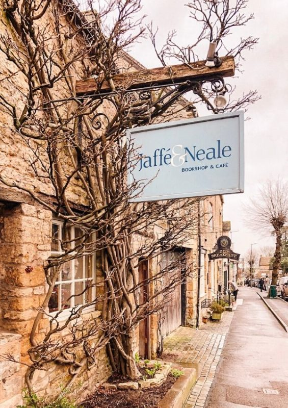 A picture of a bookshop and cafe sign in Stow on the Wold