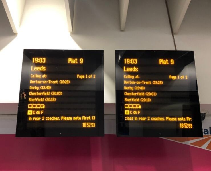 Information boards at a UK train station for trains to Leeds