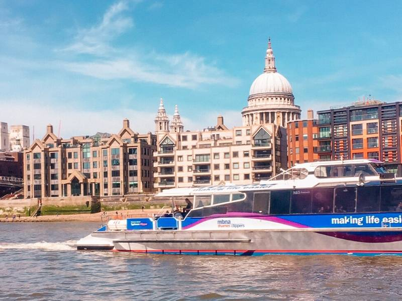 Boat on the Thames with St Paul's Cathedral in the background