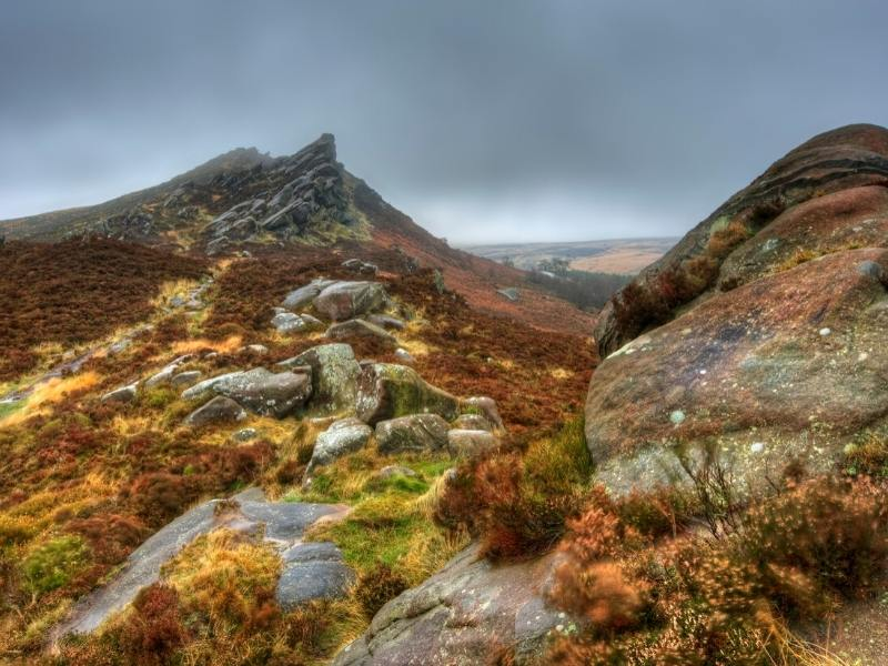 A picture of the Peak District with hills covered in moss
