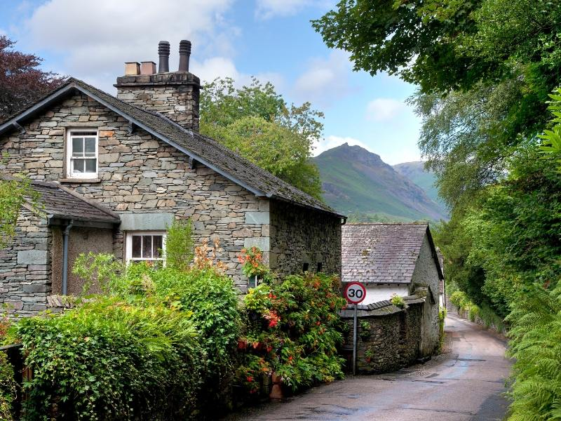 Stone houses in the village of Gresmere one of 24 pretty towns and villages in the Lake District to visit