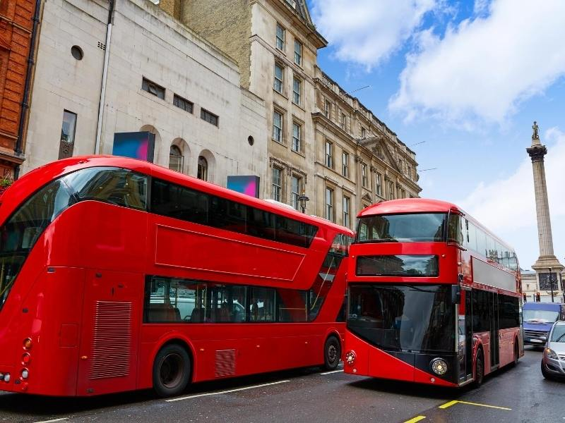 A picture of two red London Buses