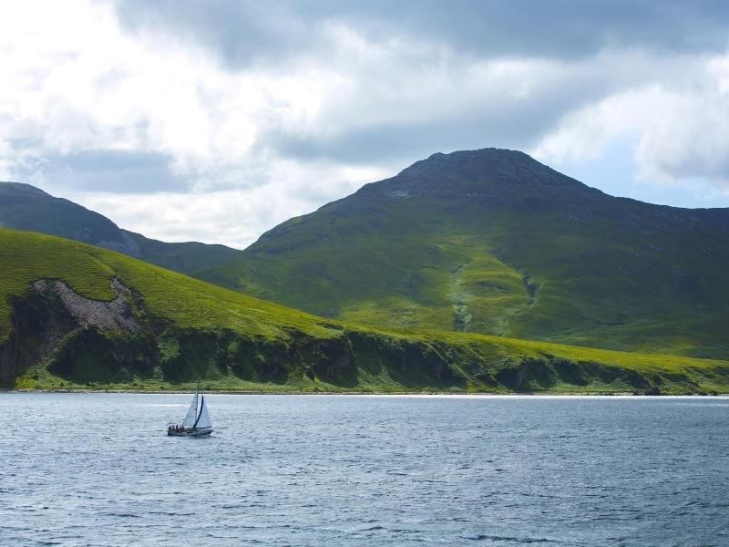 Island of Jura in Scotland with a boat sailing