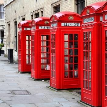 Red London phone boxes in a row