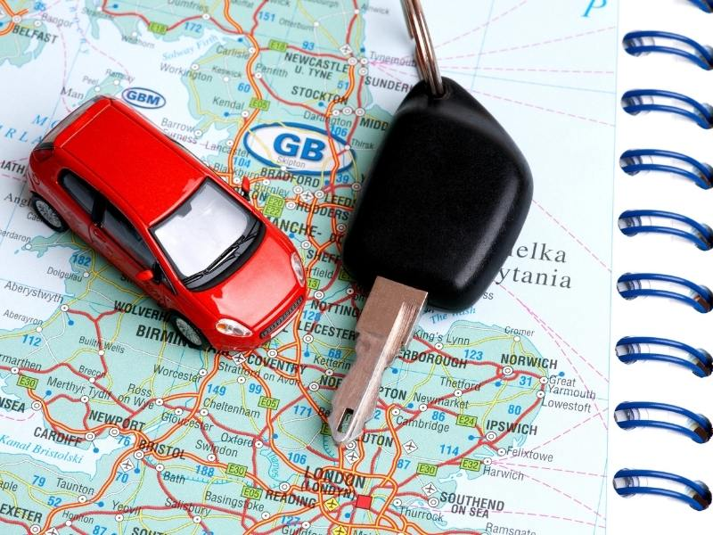 A map of England with a toy car and car keys on it