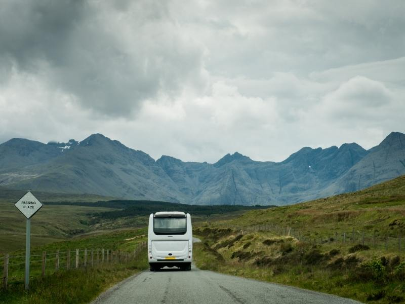 Coach heading towards hills in Scotland