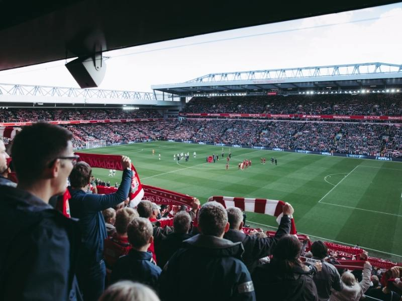 Anfield football club and people watching a match
