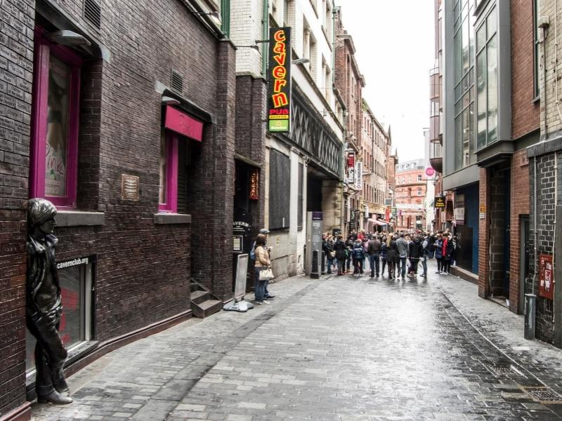 The famous Cavern Club a must visit in any Liverpool Travel Guide with statues of John Lennon in Mathew Street Liverpool