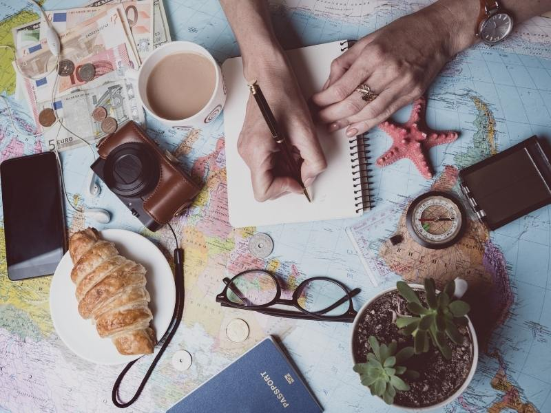 UK trip planner surrounded by travel related items