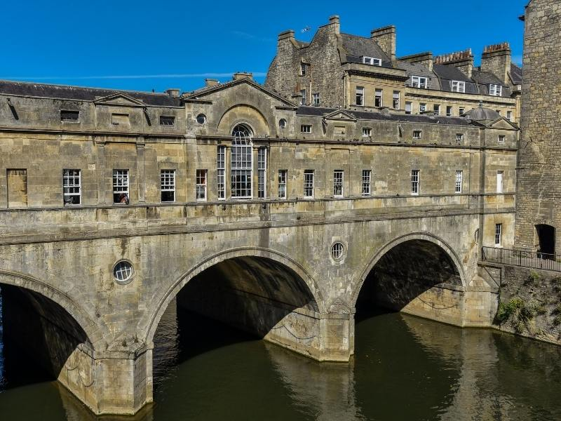 Pulteney Bridge in Bath os one of the most popular places to visit in Bath England