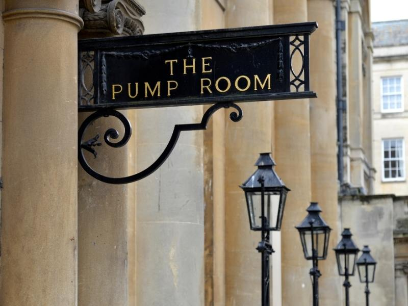 Sign for the Pump Rooms in Bath a popular attraction in Bath England