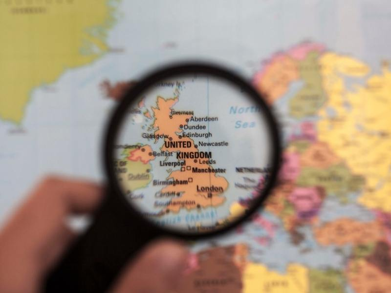 UK map under a magnifying glass as seen in many UK Travel Books.