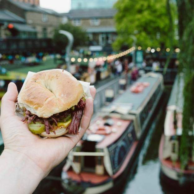 View of a canal boat and a burger.