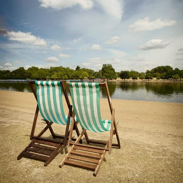 A london park with deckchairs.