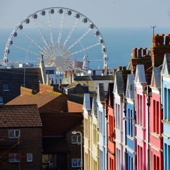 View of the Brighton wheel and colourful houses in England