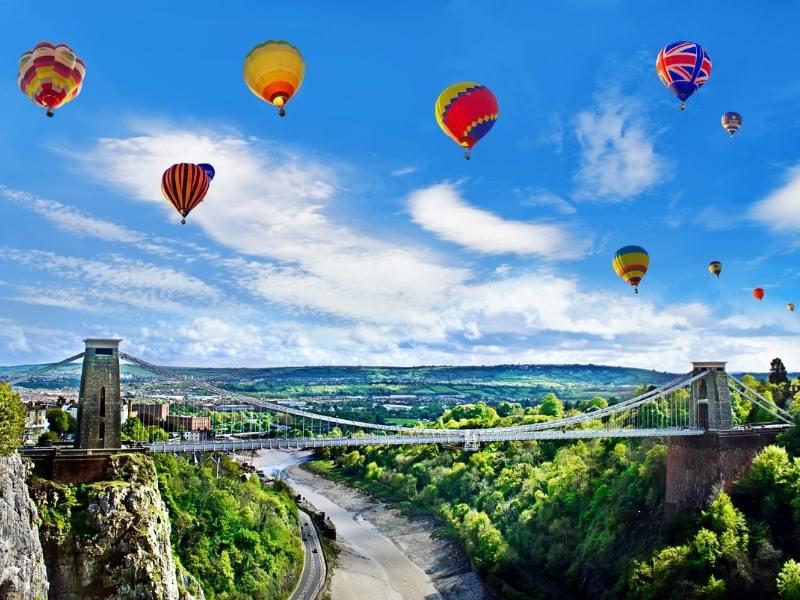 Hot air balloons over the Clifton Suspension Bridge in Bristol.