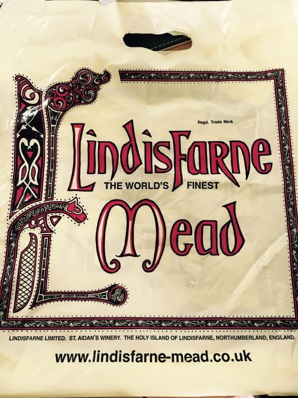A bag with the words Lindisfarne Mead.