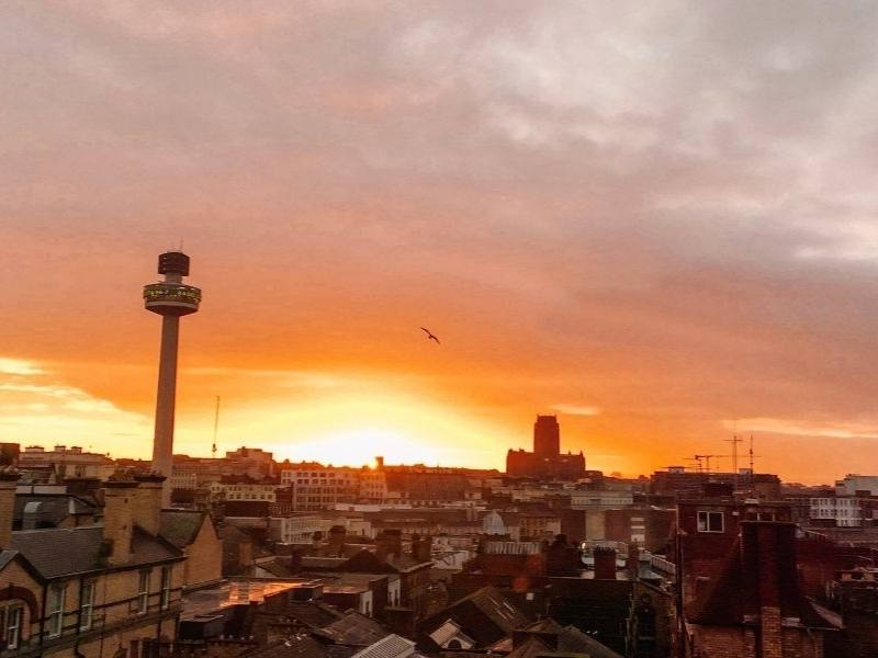 A picture of Liverpool's radio tower and city skyline at dusk