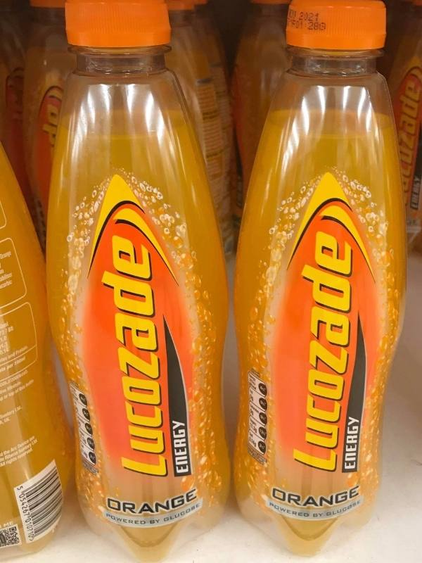 Bottles of lucozade are popular English drinks.