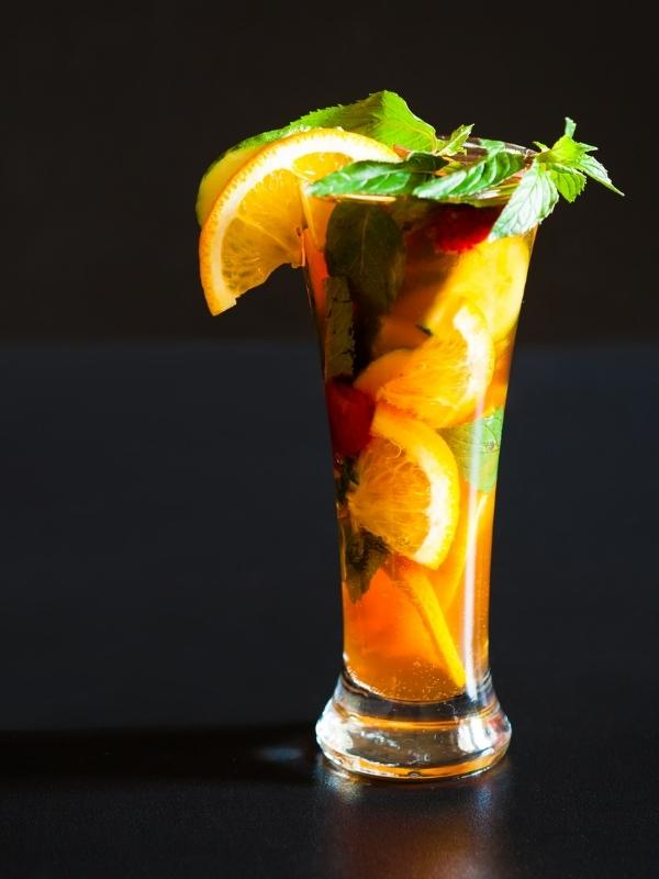 One of the most popular of English drinks a Pimms garnished with oranges and mint leaves.