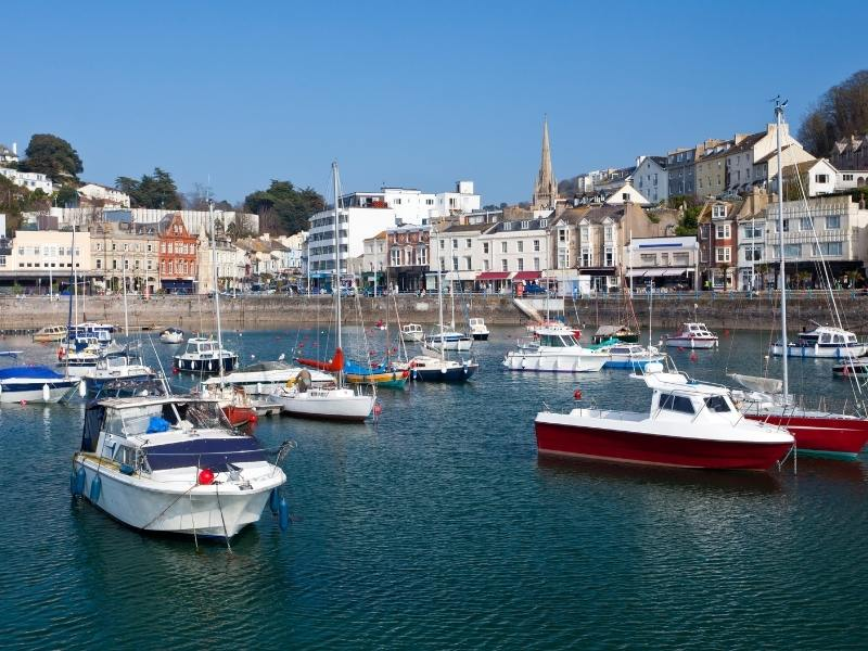 Boats in the harbour at Torquay Devon which is one of the Best places to stay in Devon.