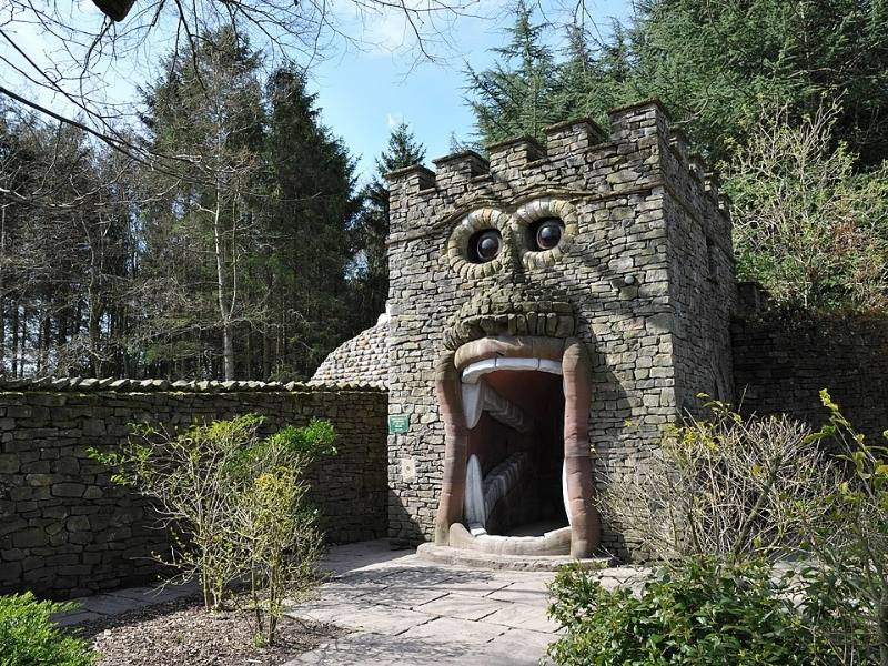 A wall with a face at the Forbidden Corner one of the best Yorkshire day trips for families.