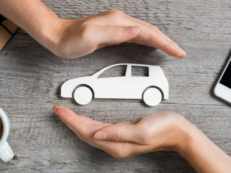 Picture of a car cupped between 2 hands.