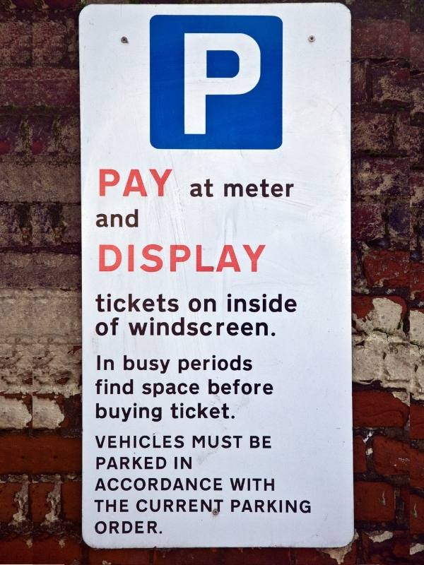 Parking signs such as this one are important to take note of when renting a car in the UK.