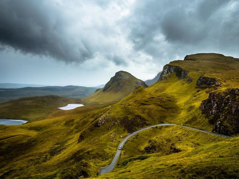 Driving in Scotland on beautiful country roads is one reason to consider renting a car in the UK.