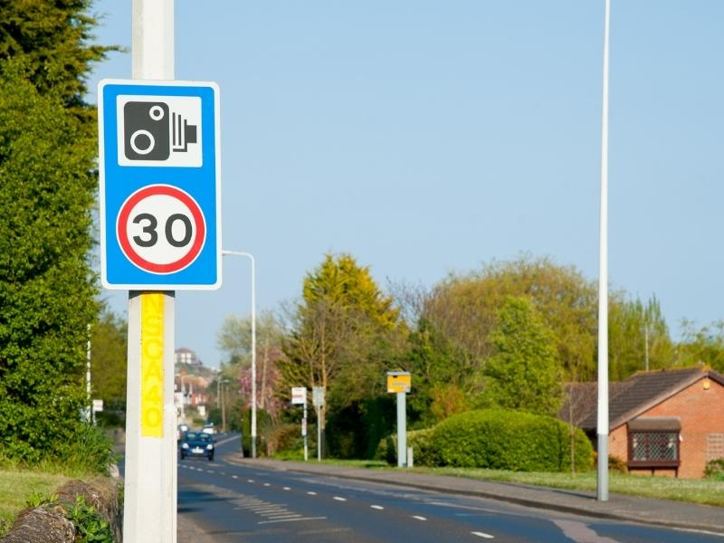 Speed limit sign in the UK.