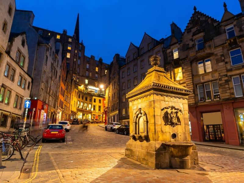 An image of Edinburgh's Grassmarket at night this is one of the best places to stay in Edinburgh.